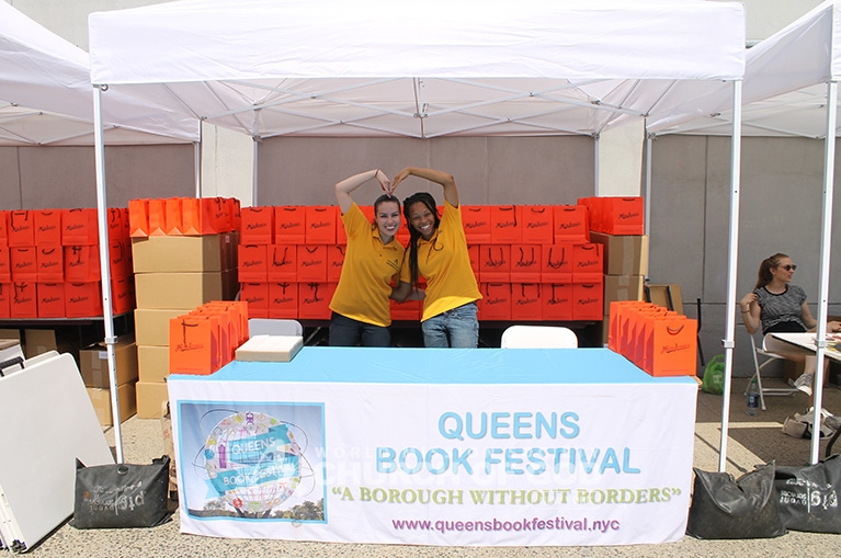 Church of God volunteers prepare to serve visitors of the Queens Book Festival.